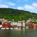 1-Bergen-Norway-bright-colored-painted-Scandinavian-houses-architecture-red-yello-orange-sea-shore-mountains-beautiful-view