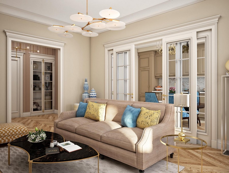 1-contemporary-neo-classical-interior-design-American-style-furniture-beige-living-room-with-white-sliding-doors-open-to-kitchen-sofa-coffee-table-brass-rug-sofa-blue-yellow-couch-throw-pillows-crown-molding-lamp