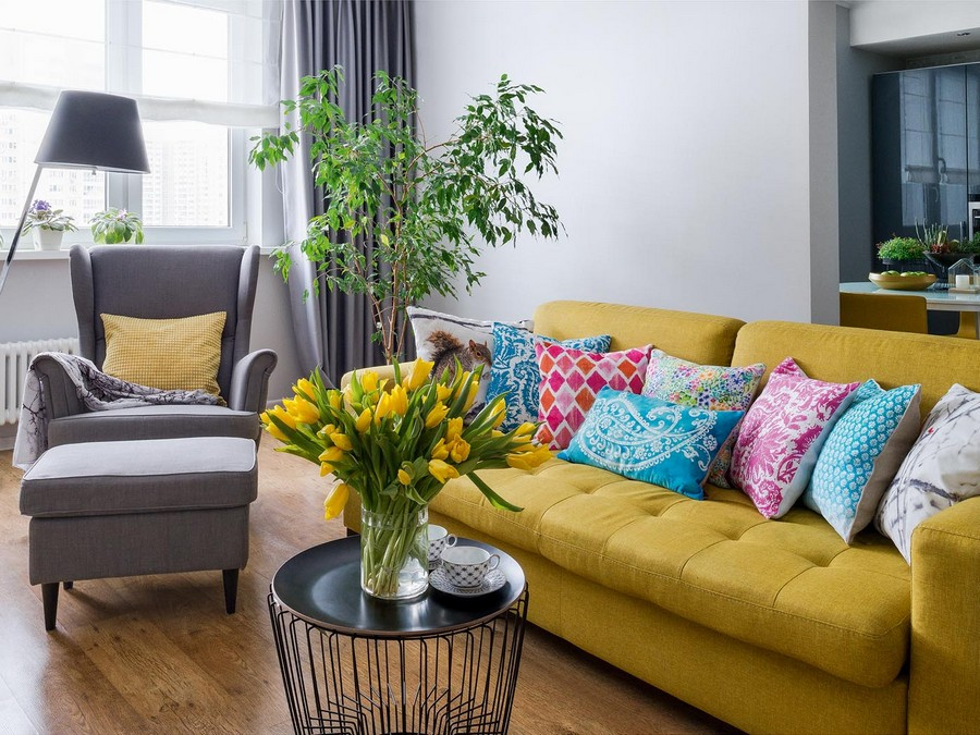 1-contemporary-style-interior-design-airy-light-bright-accents-living-room-lounge-mustard-yellow-sofa-throw-couch-pillows-tulips-coffee-table-arm-chair-with-ears-gray-curtains-oak-laminate-floor