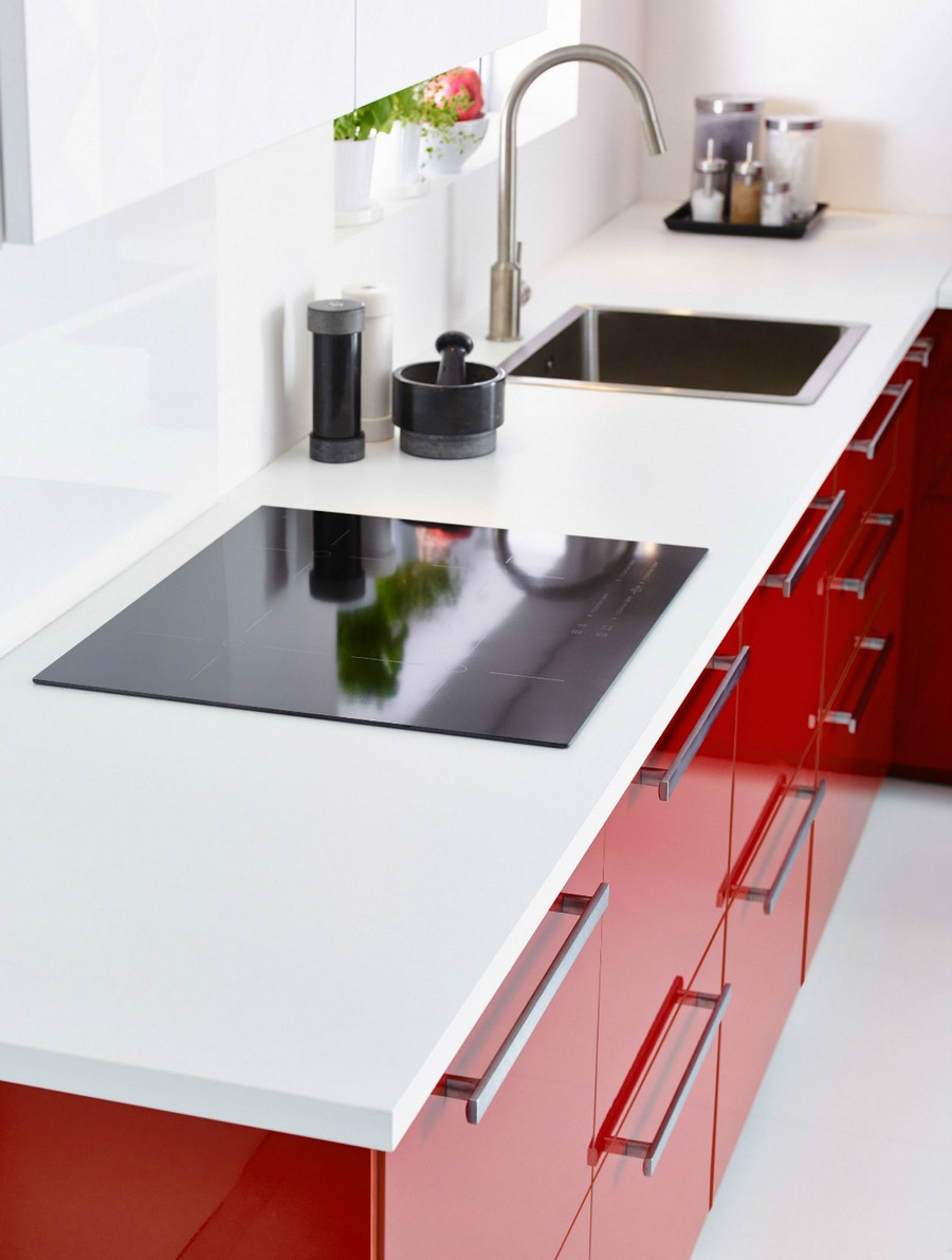 1-red-kitchen-furniture-set-cabinets-by-IKEA-glossy-sleek-metal-handles-white-worktop-backsplash-cooker