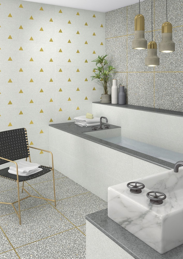 11-13-ceramic-tiles-in-interior-design-Vives-brand-collection-2017-contemporary-style-faux-marble-gray-floor-tiles-with-brass-golden-motifs-inserts-suspended-lamps-bathroom-bathtub-chair