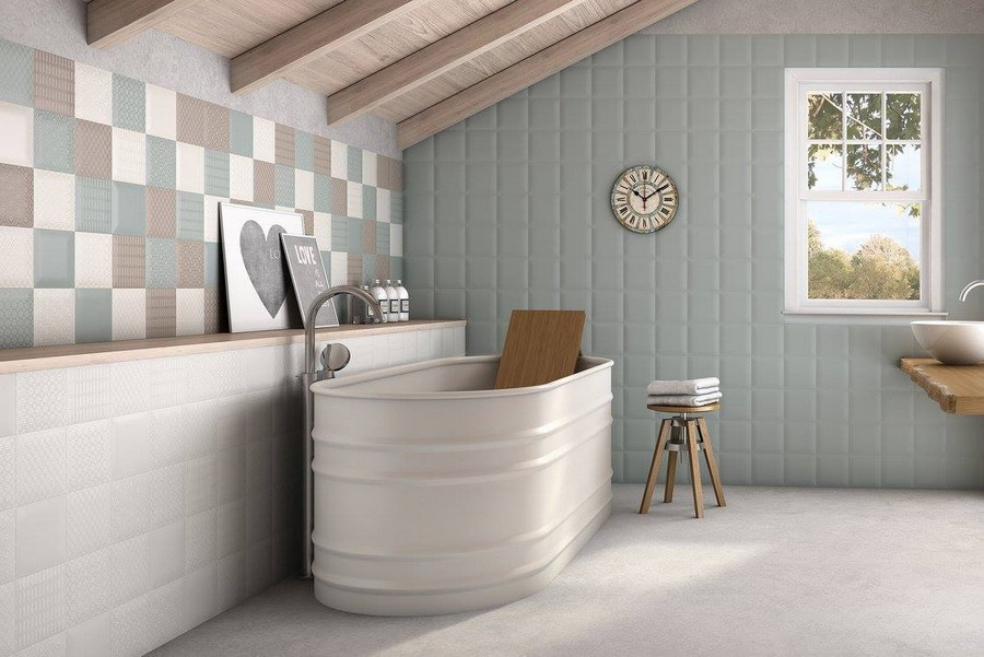 12-3-ceramic-tiles-in-interior-design-Cas-Ceramica-brand-collection-2017-attic-floor-bathroom-pastel-blue-wall-tiles-square-shaped-acrylic-bathtub-wooden-stool-countertop-window-sloped-ceiling-beams