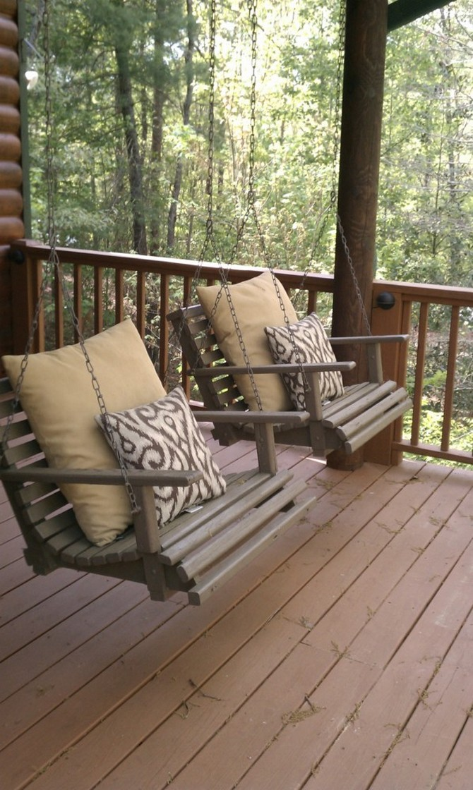 2-1-beautiful-garden-swing-double-on-a-terrace-outdoor-forest-wood-view-pillows-wooden-seats