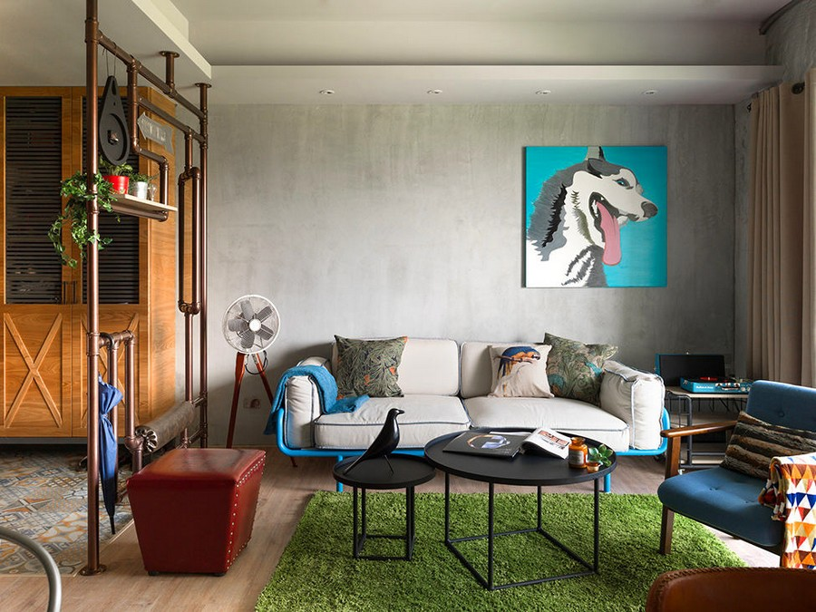 2-2-open-concept-living-room-interior-design-Taiwan-dog-artwork-blue-and-gray-sofa-metal-coffee-tables-arm-chair-ottoman-loft-style-motifs-metal-pipes-decor