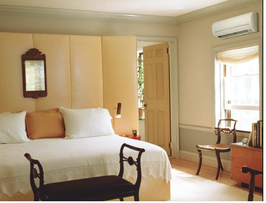 2-air-conditioner-in-the-bedroom-interior-design-traditional-style-beige-walls-white-bed-linen-pillows-bedside-bench-chair-roman-blind