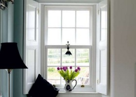 2-beautiful-sash-windows-white-purple-tulips-flower-vase-black-lamp-white-walls-throw-pillow