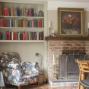 2-old-country-house-interior-design-vintage-style-aged-floor-fireplace-book-shelves-arm-chair-living-room-reading-nook-floral-pattern