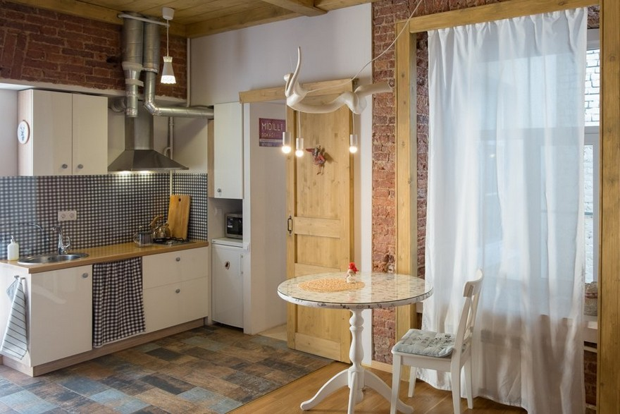 historical studio apartment with folk motifs brick wall home interior design kitchen and. Black Bedroom Furniture Sets. Home Design Ideas