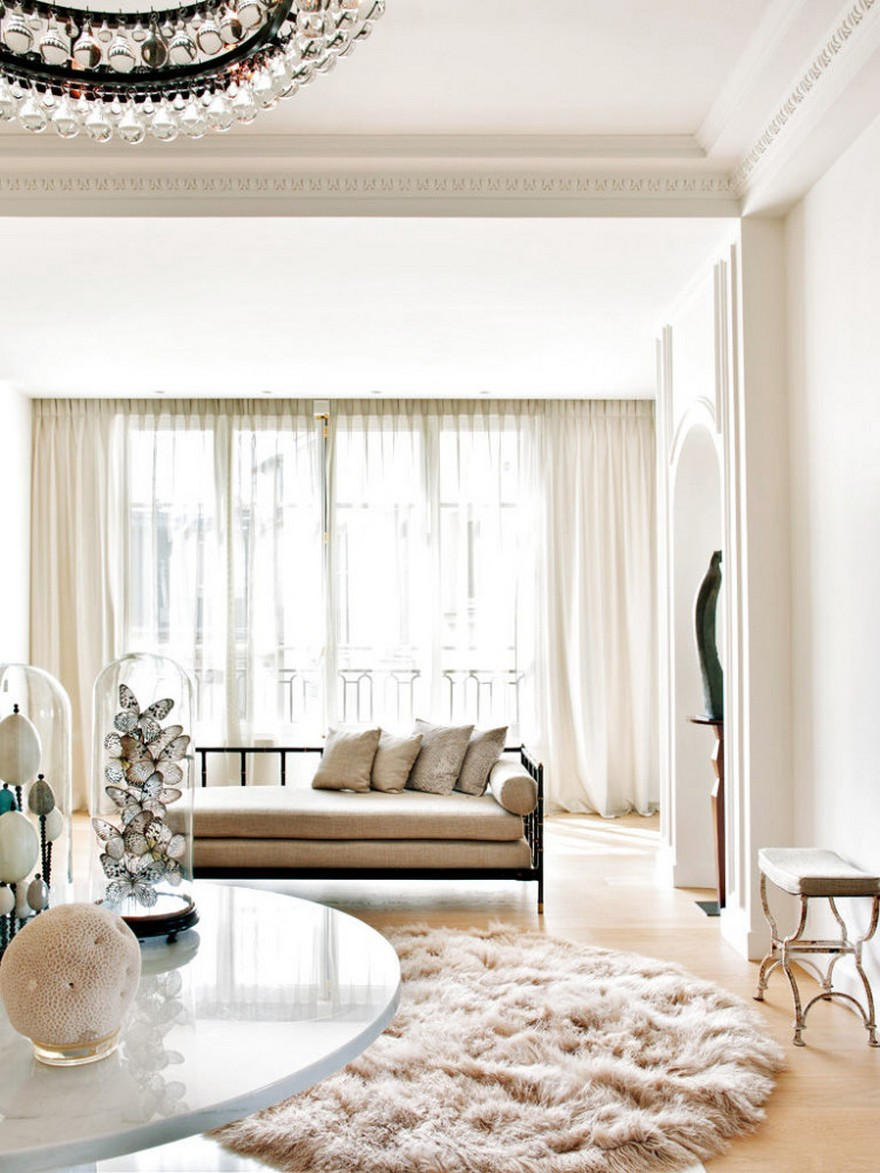 3-1-Paris-apartment-interior-design-contemporary-style-by-Stephane-Olivier-light-white-walls-pastel-colors-luxurious-lounge-corridor-couch-beige-pillows-Mongolian-sheep-woolen-rug-marble-table-sculpture