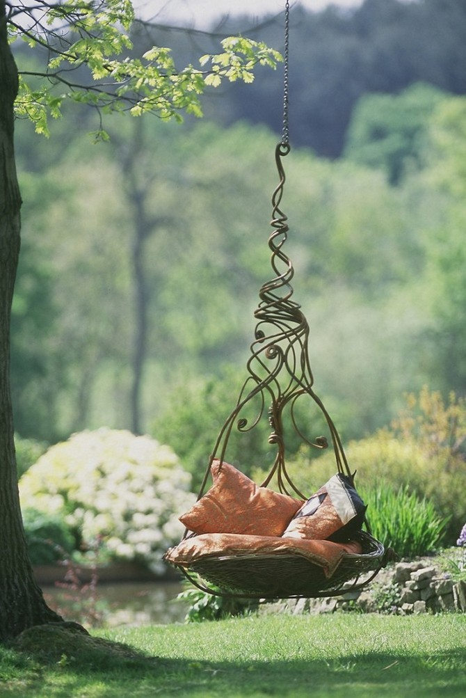 3-2-beautiful-garden-swing-metal-wrought-cushions