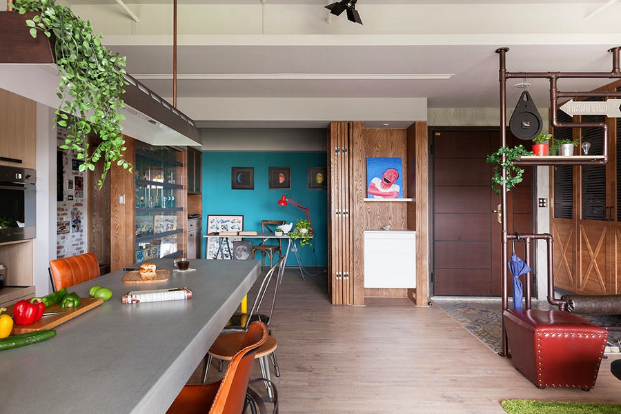 3-2-open-concept-living-room-dining-area-kitchen-interior-design-Taiwan-study-work-area-desk-entry-zone-metal-pipe-decor-loft-style-motifs-blue-wall-wooden-folding-door-partition