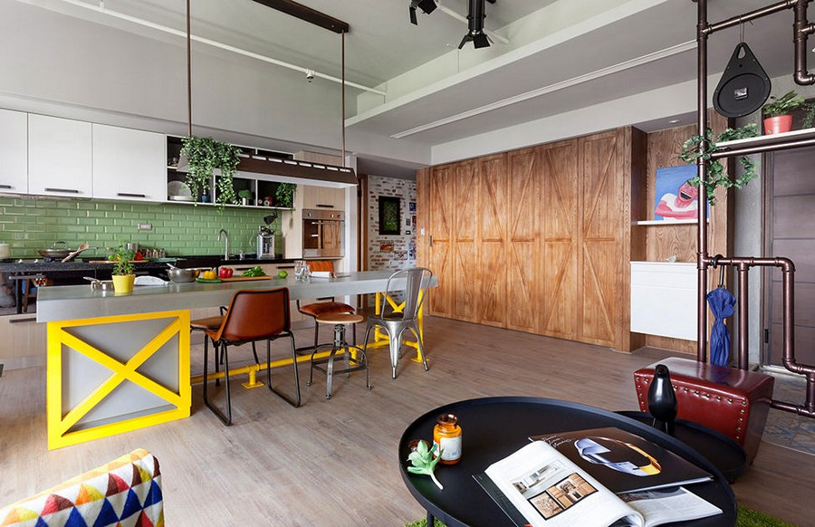 3-3-open-concept-living-room-dining-area-kitchen-interior-design-Taiwan-pastel-green-backsplash-tiles-yellow-bar-table-legs-island-mismatched-chairs-stools-coffee-table-wooden-folding-door-partition
