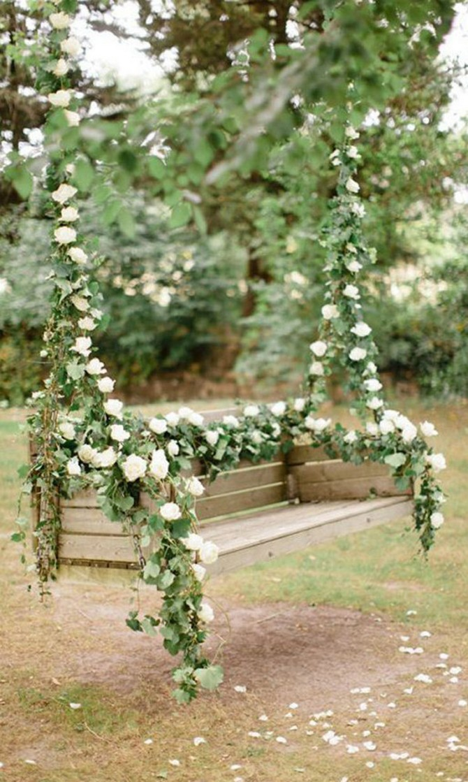 3-5-beautiful-garden-swing-wooden-bench-seat-decorated-with-white-flowers
