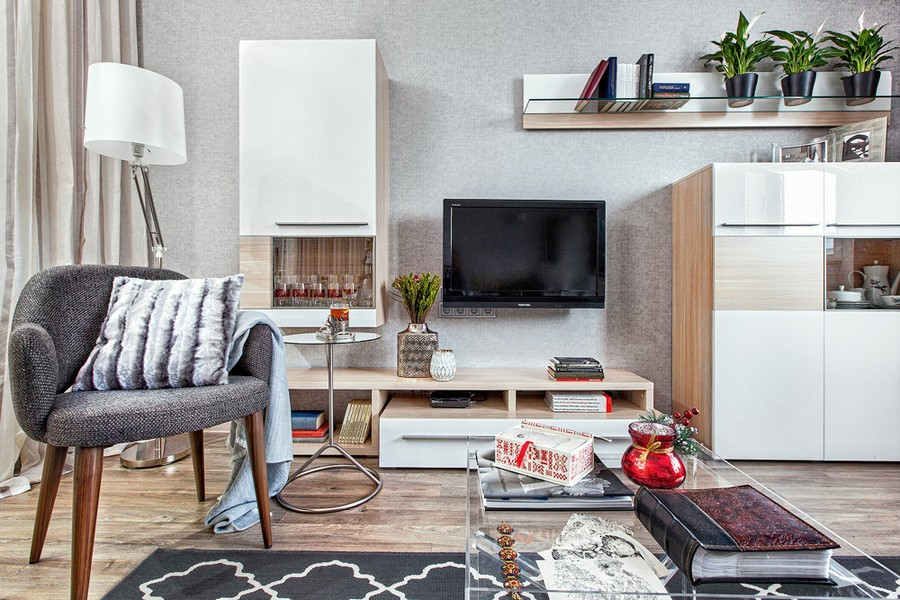 3-contemporary-style-interior-design-living-room-laminate-floor-light-gray-walls-arm-chair-white-glossy-cabinets-geometrical-black-and-white-rug-transparent-coffee-table-floor-lamp