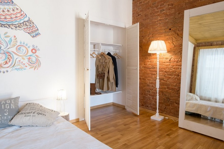 3-studio-apartment-interior-design-folk-style-ethnicak-motifs-white-wall-painting-mythical-bird-masonry-historical-brick-wall-hand-made-bed-built-in-wardrobe-closet-floor-lamp-full-length-mirror