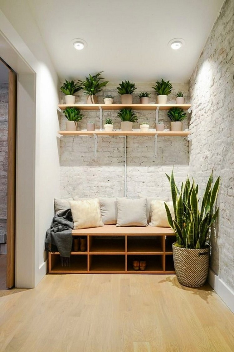 4-2-hallway-entry-room-entrance-hall-mudroom-interior-design-shoe-storage-ideas-beige-wooden-bench-pillows-indoor-plants-faux-brick-wall-light