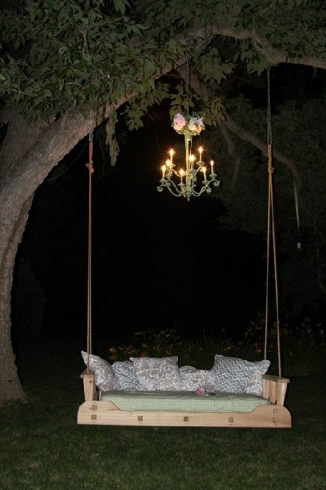 4-5-beautiful-garden-swing-night-chandelier-big-tree-rope-suspended-wooden-bench-cushions-pillows