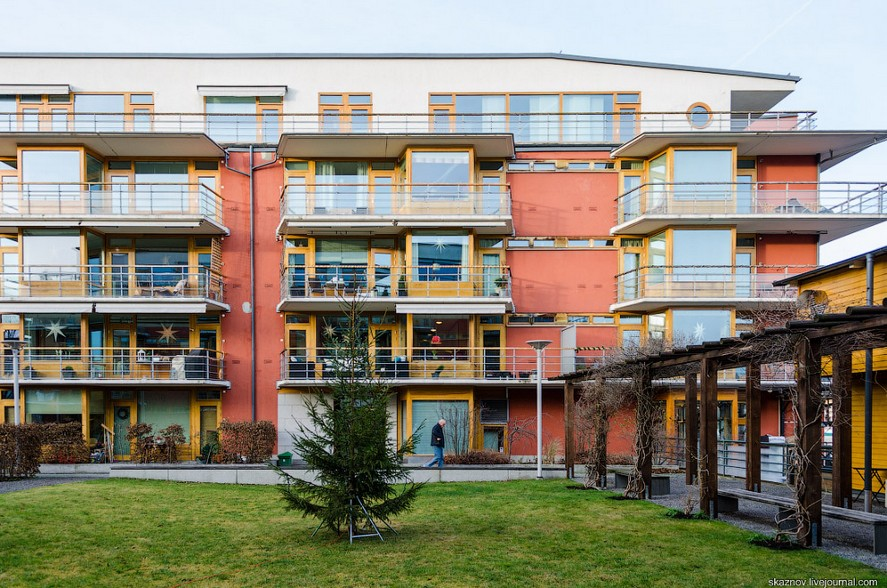 4-Stockholm-Sweden-bright-colored-painted-Scandinavian-houses-architecture-yellow-red-balconies-living-quarters