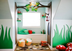 4-kid's-playroom-toddler-room-interior-design-window-sill-bench-carved-wooden-decor-grass-shaped-wall-tree-fly-agaric-ottomans-fairy-tale-magical-woodland