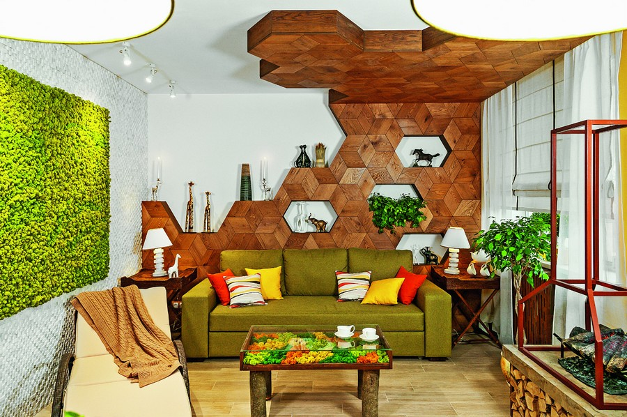 4-wooden-ceiling-decor-in-interior-design-3D-hexagonal-wall-decor-oak-panels-eco-style-living-room-green-stabilized-moss-vertical-garden-coffee-table-sofa-yellow-orange-accents-fireplace