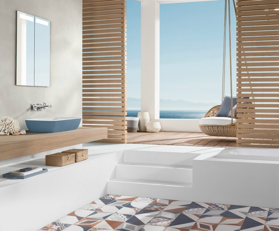 5-1-Villeroy-&-Boch-beige-bathroom-interior-design-wash-basin-vanity-unit-light-wood-countertop-white-rack-stairs-terrace-exit-floating-arm-chair-blue-top-mounted-sink-wicker-baskets-geometrical-floor-tiles