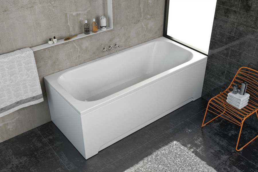 6-2-Kolpa-San-beige-bathroom-interior-design-rectangular-bathtub-wicker-chair-brutal-gray-wall-floor-tiles-towel-shelf-shaggy-rug