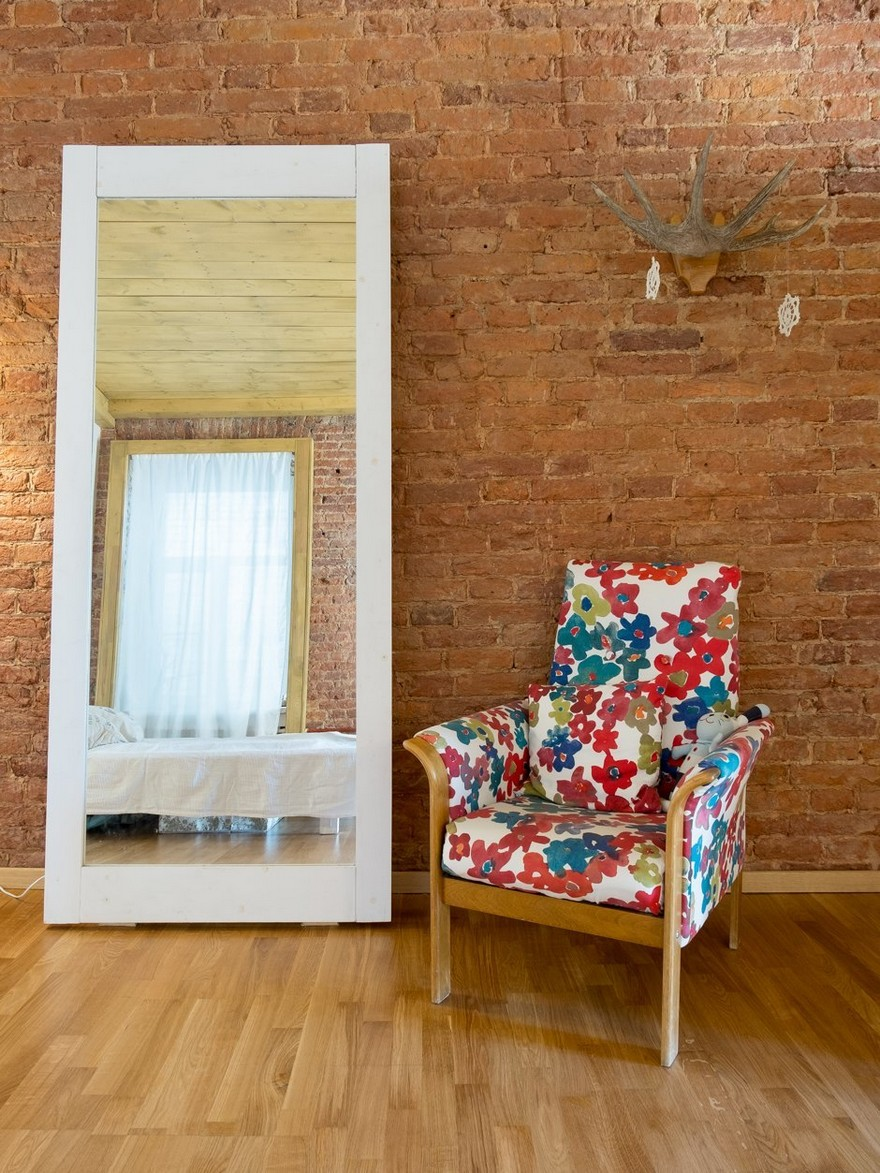 6-2-historical-brick-wall-masonry-white-full-length-mirror-bright-upholstered-retro-style-arm-chair-laminate-floor-in-interior-design