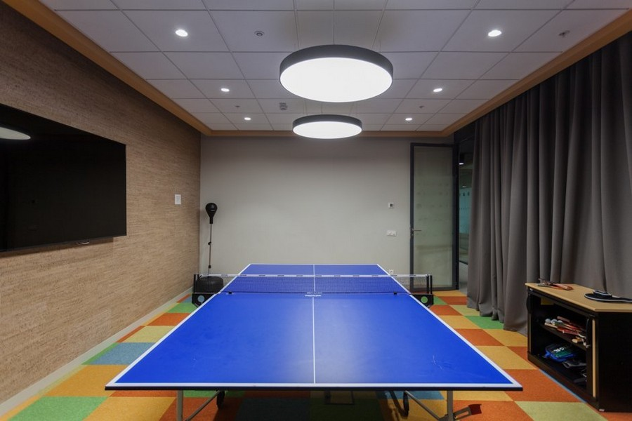 7-1-new-refreshed-renovated-Microsoft-office-headquarters-in-Moscow-interior-design-gym-sports-room-ping-pong-table-Tv-set