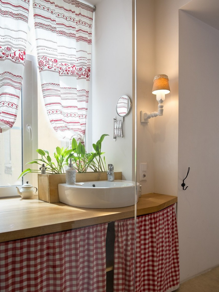 7-bathroom-interior-design-folk-style-motifs-chequered-curtains-embroidered-curtains-red-and-white-wall-lamps-sconce-round-mirror-big-window-top-mounted-wash-basin-sink-home-garden-flower-pots