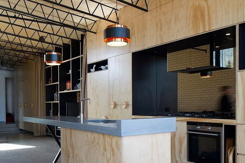 7-elongated-kitchen-interior-design-open-concept-veneer-cabinets-light-plywood-polished-concrete-floor-metal-ceiling-decor-black-backsplash