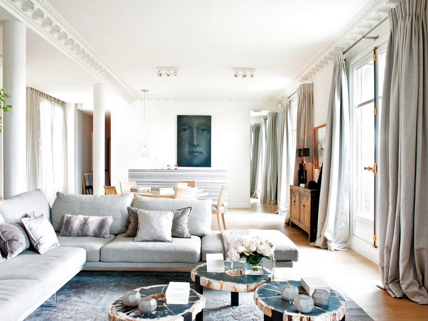 8-1-Paris-apartment-interior-design-contemporary-style-by-Stephane-Olivier-light-white-walls-pastel-colors-living-dining-room-open-concept-gray-corner-sofa-artwork-big-panoramic-windows-coffee-table-antique-cupboard-columns