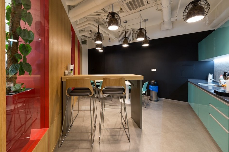 9-1-Mattel-office-interior-design-Russia-Moscow-toys-seller-dining-zone-area-turquoise-bar-red-walls-wooden-table-bar-stools-exposed-ceiling-wires-black-pendant-lamps-chalkboard-wall