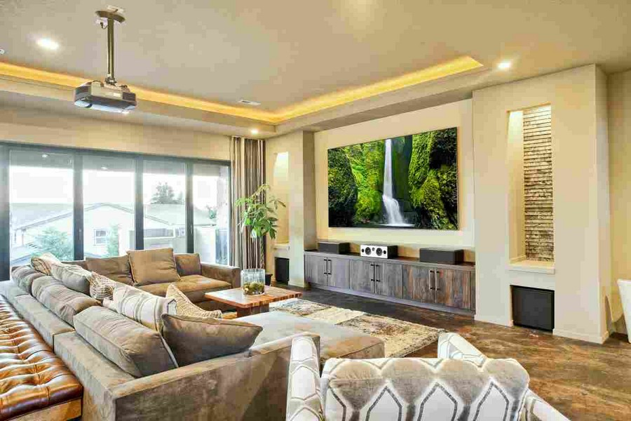 0-home-theater-home-cinema-movies-in-interior-design-traditional-style-living-room-projector-wall-recess-built-in-system-beige-walls-comfy-corner-sofa-cozy-panoramic-windows-wooden-cabinet