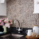 0-original-creative-kitchen-backsplash-ideas-in-interior-design-white-cabinets-pebbles-black-worktop-countertop