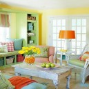 00-beautiful-cozy-living-room-interior-design-ideas-country-style-vintage-aged-coffee-table-arm-chair-bright-cheerful-colors-light-green-wardrobe-yellow-walls-orange-accents-floor-lamp-throw-pillows-sofa-window-bench