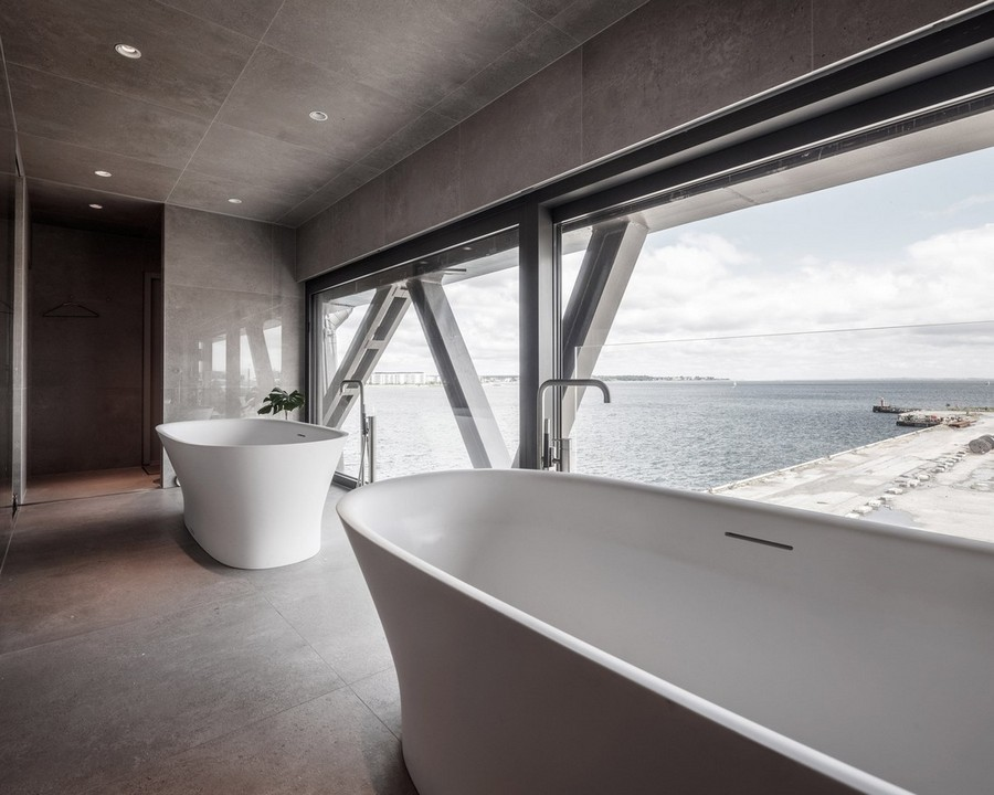 1-2-remade-reconstructed-ex-harbor-crane-apartment-in-Copenhagen-dark-black-graphite-gray-interior-panoramic-windows-sea-port-view-free-standing-bathtub-bath-SPA-bathroom