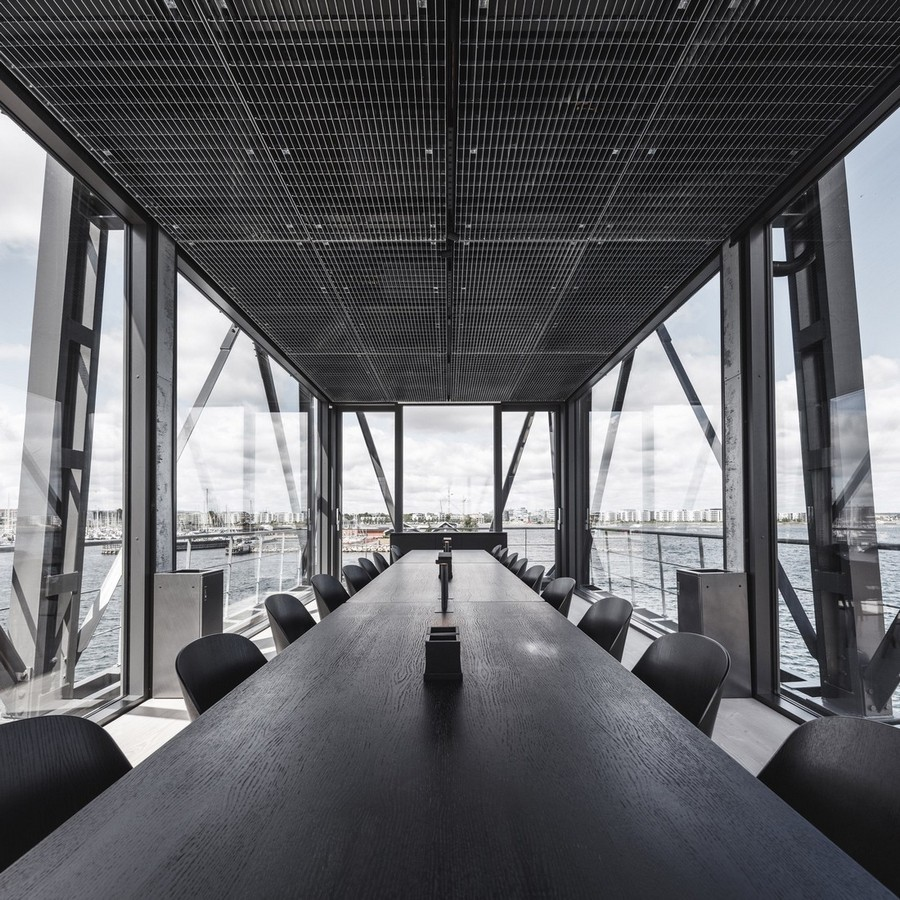 1-3-remade-reconstructed-ex-harbor-crane-apartment-in-Copenhagen-dark-black-graphite-gray-interior-long-negotiation-table-metting-room-conference-hall-panoramic-windows-sea-port-view