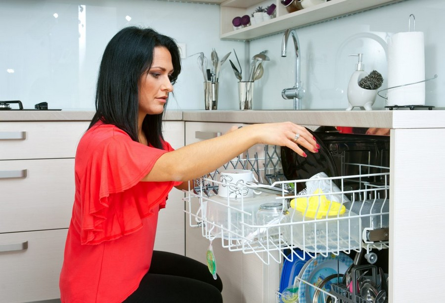 1-attractive-woman-using-dun-loading-dishwasher-dishwashing-machine