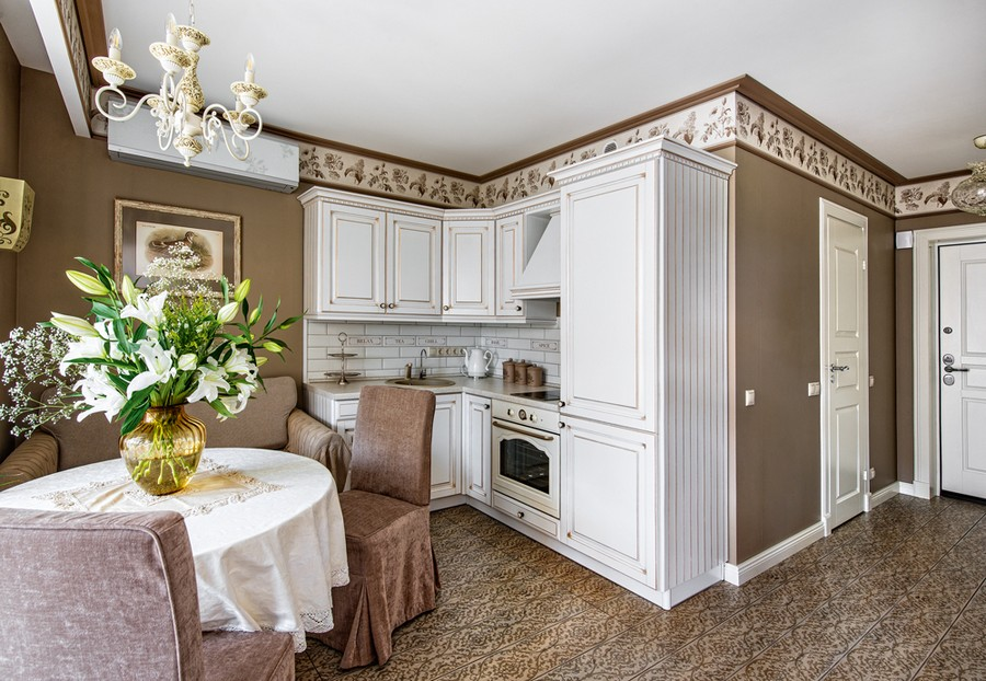 1-neo-classical-style-interior-design-in-beige-brown-and-white-kitchen-dining-area-hallway-corridor-door-panelling-casing-baseboard-wallpaper-frieze-backsplash-air-conditioner-round-table-chairs-slip-covers-floor-tiles