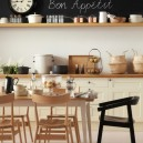 10-dining-room-area-interior-design-ideas-bistro-kitchen-country-style-light-wooden-cabinets-open-racks-chalkboard-wall-paint-mismatched-chairs-black-white-backsplash