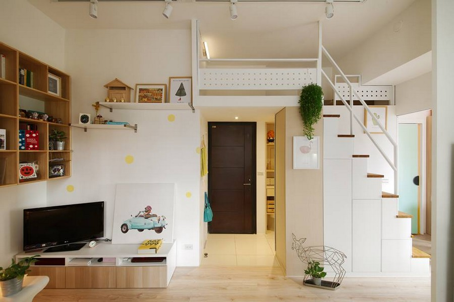2-2-interior-by-A-Lentil-Design-Taiwan-China-white-walls-light-panoramic-windows-living-room-TV-stand-bookshelves-staircase-attic-loft-room-perforated-iron-board-indoor-plants-laminate-mudroom-entrance-hall
