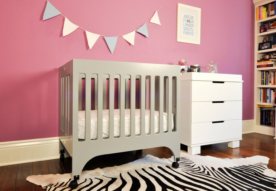 2-2-toddler-baby-bed-white-wooden-minimalist-style-cot-nursery-room-interior-zebra-rug-pink-painted-wall-shelves