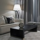 2-3-Armani-Casa-luxurious-interior-design-beige-sofa-living-room-black-coffee-table-curtains-floor-lamp-couch-pillows