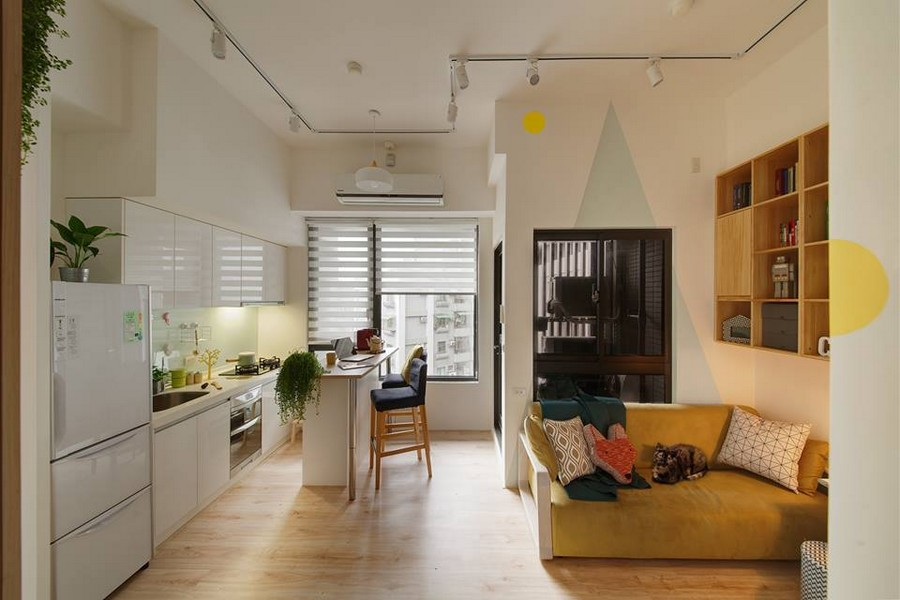 2-3-interior-by-A-Lentil-Design-Taiwan-China-white-walls-light-panoramic-windows-kitchen-open-plan-living-room-lounge-geometric-motifs-white-cabinets-island-yellow-sofa-bookshelves