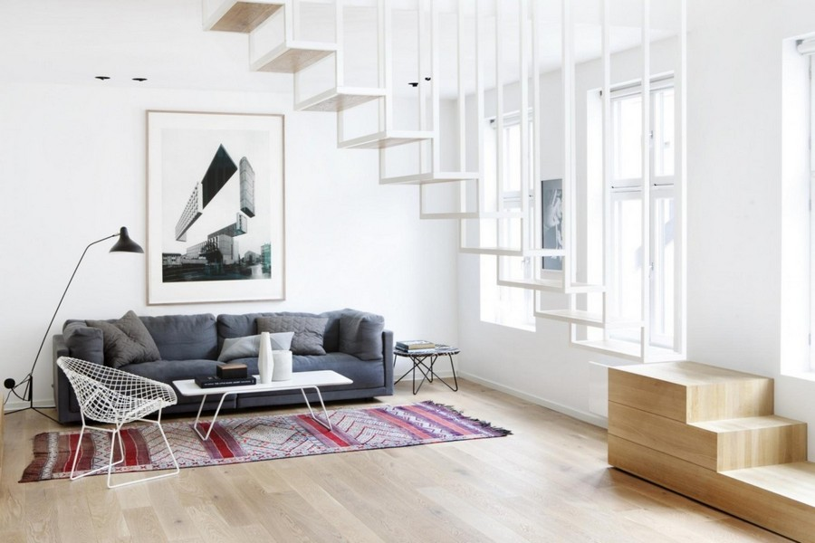 2-3-metal-staircase-stairs-loft-style-minimalist-interior-white-walls-gray-sofa-stripy-rug-floor-lamp-wall-art-attic