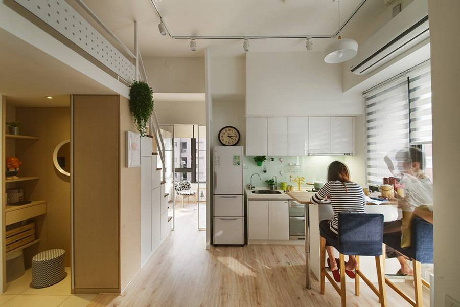 2-4-interior-by-A-Lentil-Design-Taiwan-China-white-walls-light-panoramic-windows-open-plan-kitchen-white-cabinets-island-young-people-breakfast-track-lights-laminate-clock-cloakroom-walk-in-closet