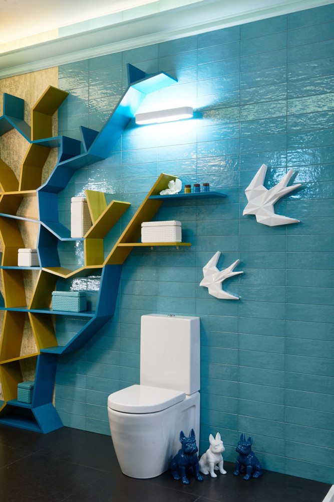 2-creative-bathroom-interior-design-eclectic-eco-style-shelving-unit-tree-shaped-turquoise-blue-glazed-wall-tiles-golden-wallpaper-Omexco-floor-mounted-toilet-by-Duravit-picture-lights-birds-dogs-statuettes-decor