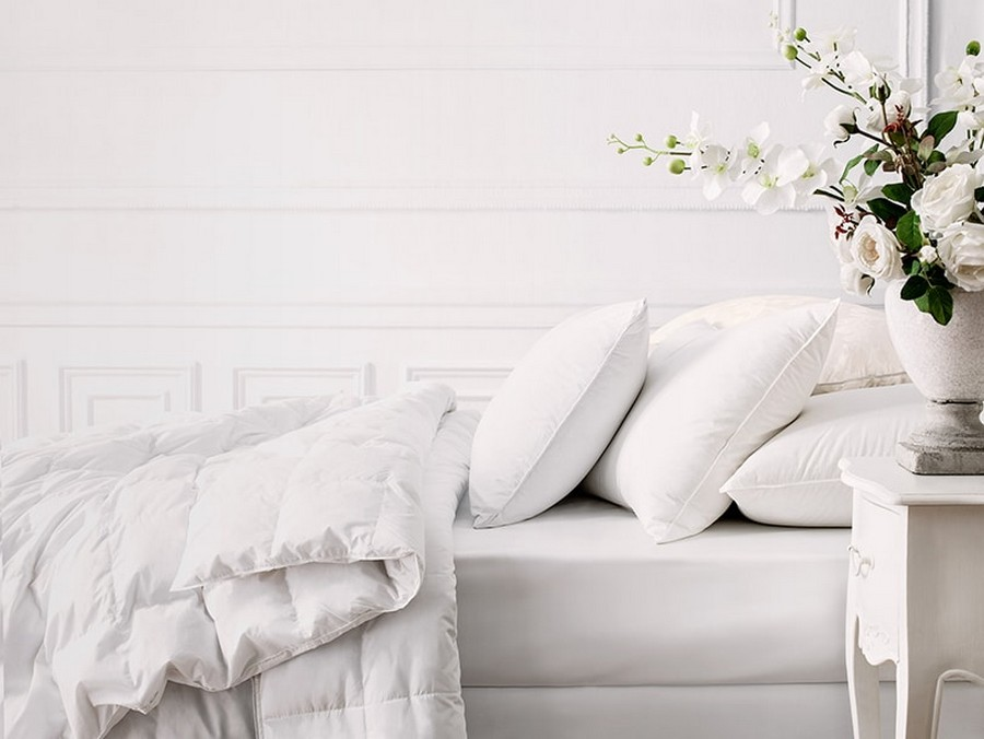 2-total-white-bedroom-interior-design-white-walls-white-furniture-panelling-nightstand-flower-vase-bed-linen