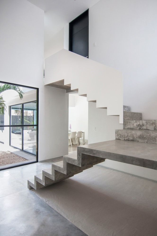 3-2-concrete-staircase-stairs-white-railing-walls-minimalist-style-interior-design