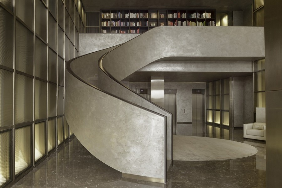 3-3-Armani-Casa-luxurious-interior-design-spiral-staircase-home-library-gray